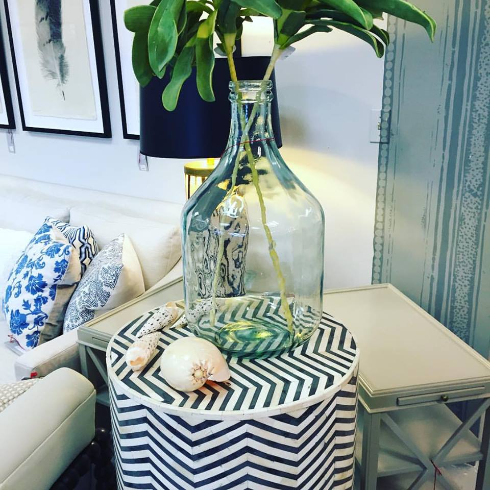 We just received our newest bone inlayed stools, this time with grey. Large jug vases have been on the scene and we have them simply styled with faux leafy greens.