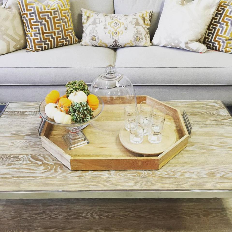 The chrome and wood coffee table brings this whole vignette together- it's an organic-meets-shiny-finish type of living area. Love the cake stand with the mini pumpkin and hydrangea arragement.