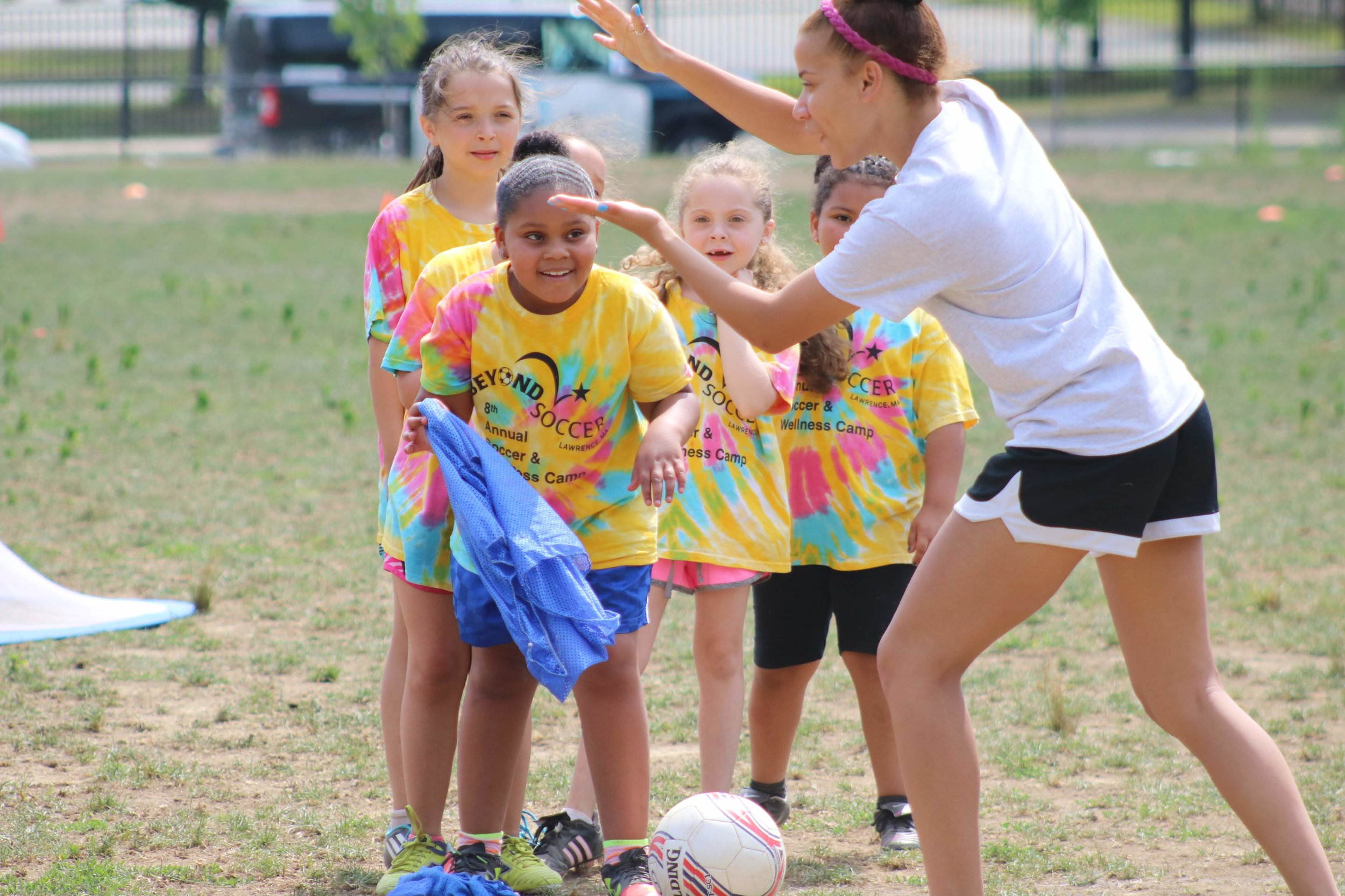 Pictures of Coach Mentor Oriagna, who started with us on our first girls team, the Wolves, instructing girls during our Annual Soccer & Wellness Camp in 2018.