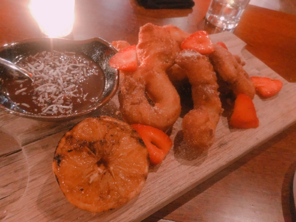 For dessert, the churros and a chocolate dipping sauce with hints of orange and coconut flakes