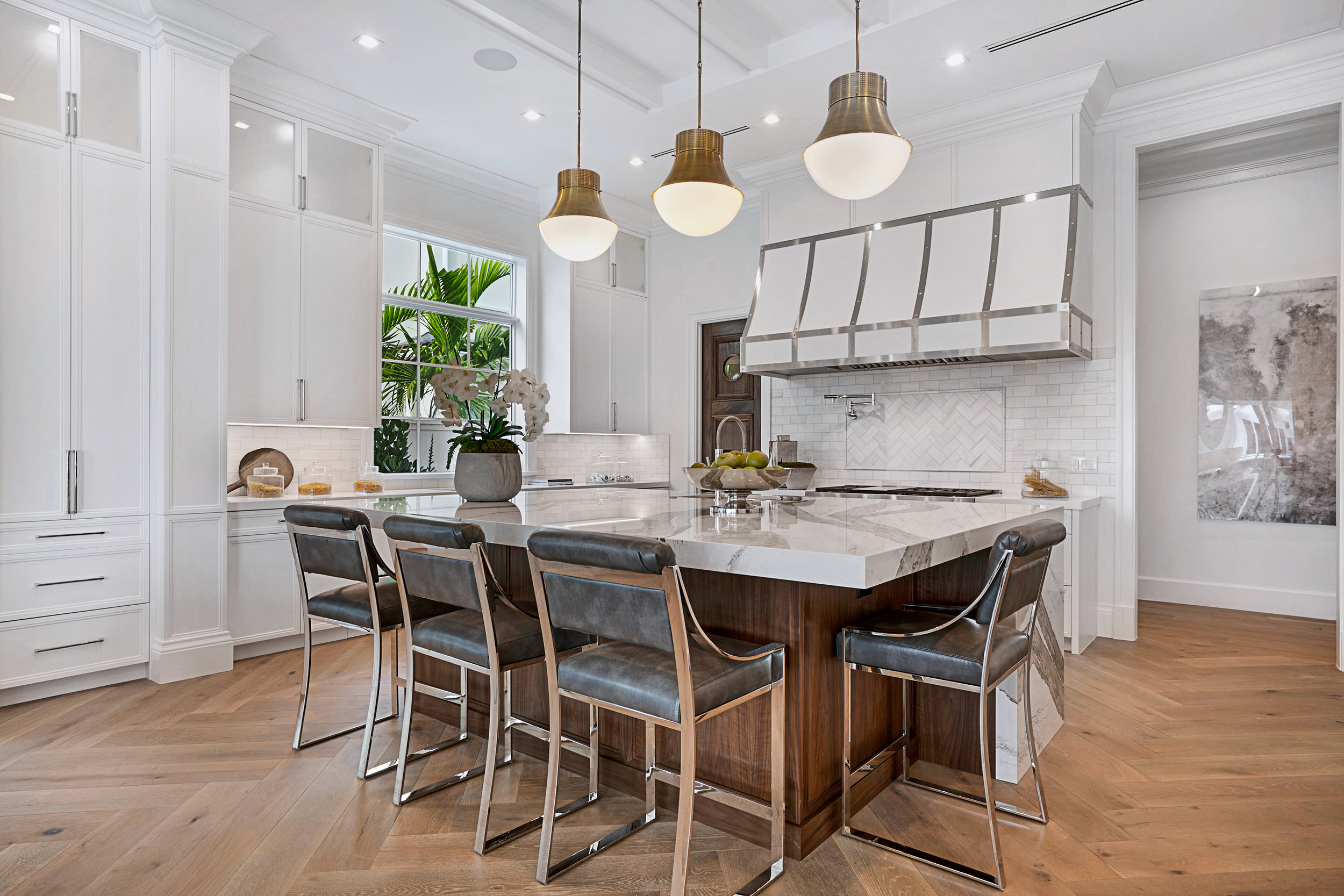 "Boca Raton luxury home equipped with Chef's Kitchen, custom pantry, and ""bespoke"" hood."