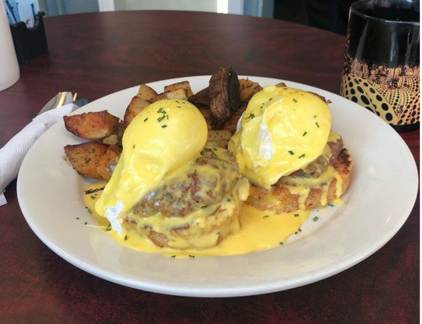 Hogs In A 'Daise - Homemade pork sausage Benedict served on biscuits