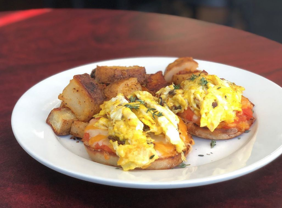 Brunchables - Eggs scrambled with cheddar jack and bacon on top of and English smeared with pizza sauce