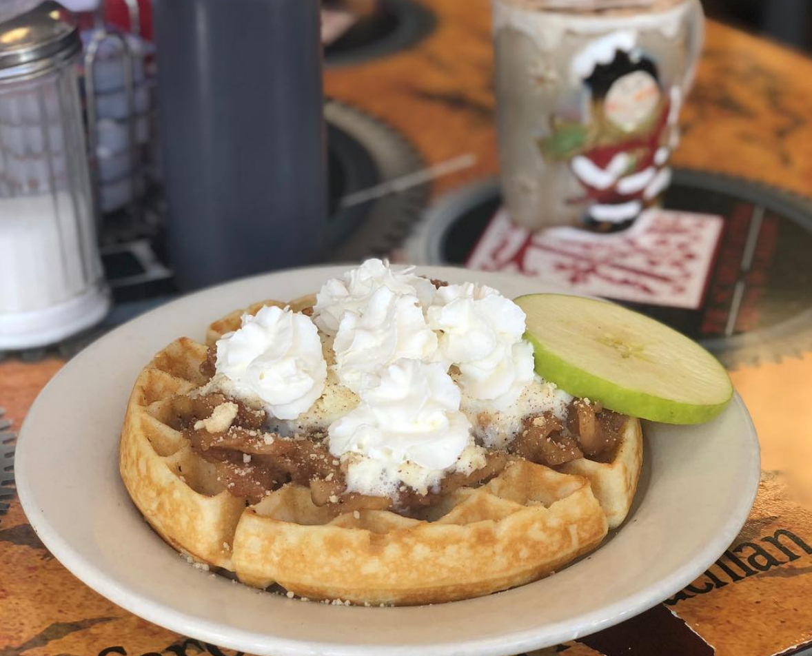 PHANTOM OF THE ORCHARD - Waffle topped with apple compote, whipped cream, and caramel drizzle
