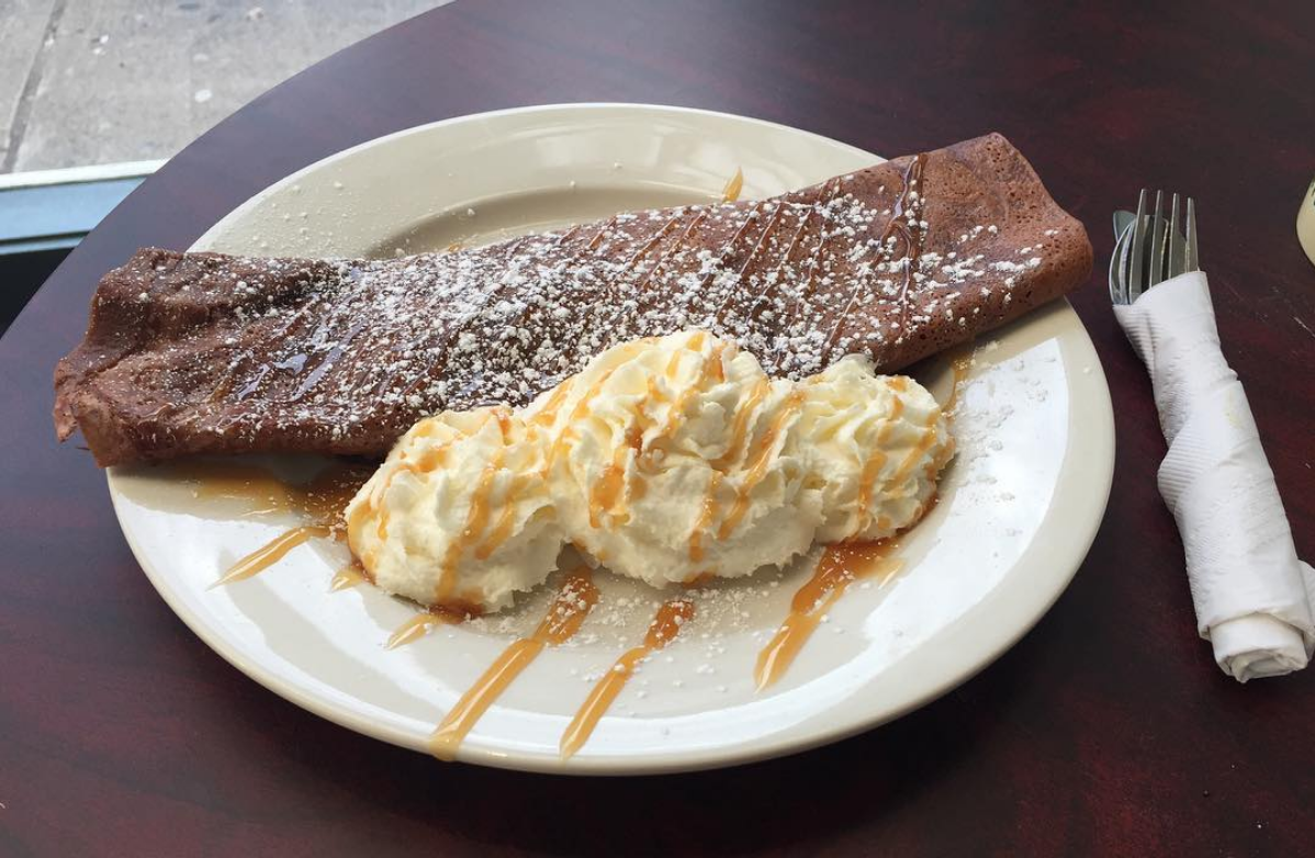 Double chocolate strawberry crepe, served with whipped cream and caramel drizzle
