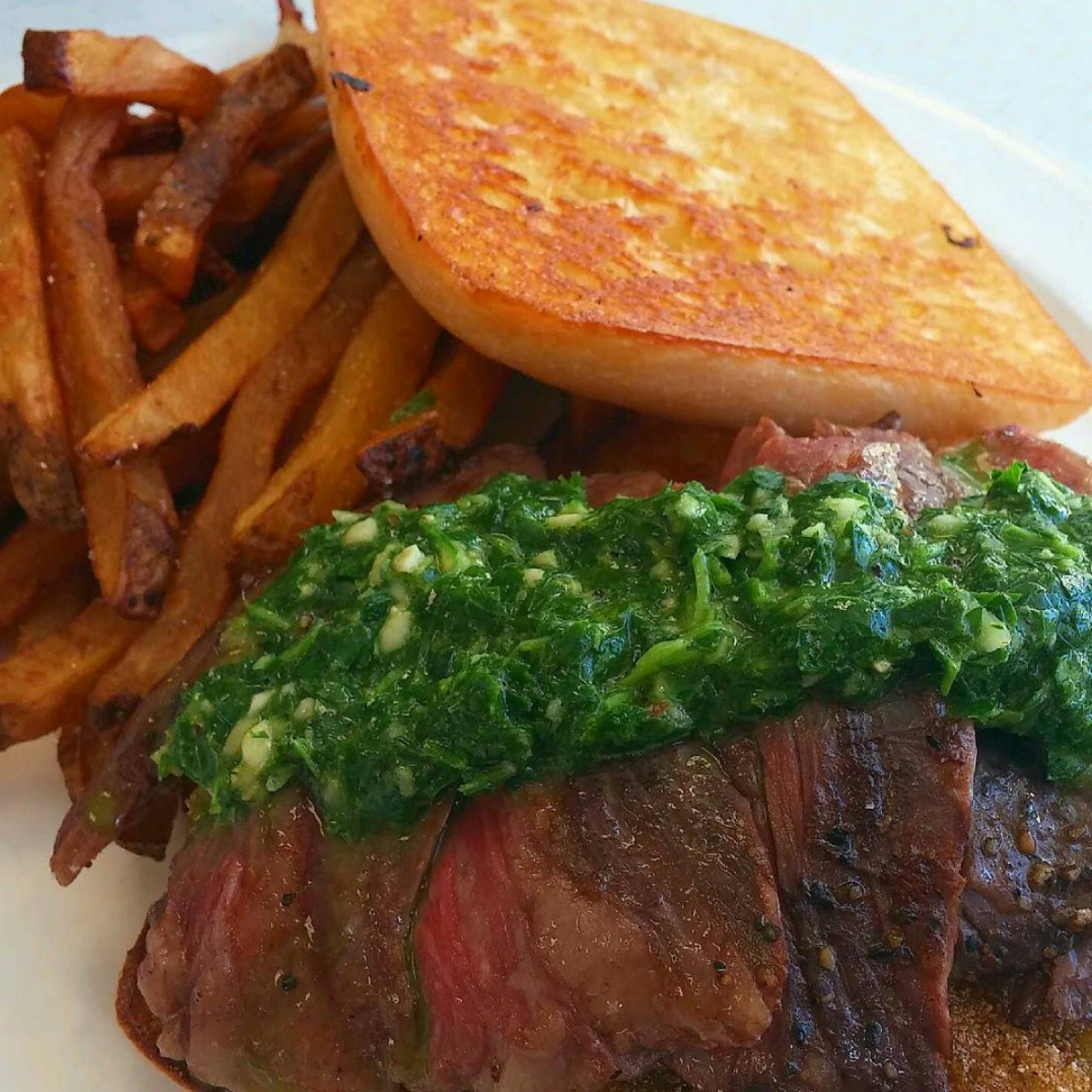 Skirt Steak Sammich - Med rare marinated skirt steak served atop fried green tomatoes and topped with chimichurri