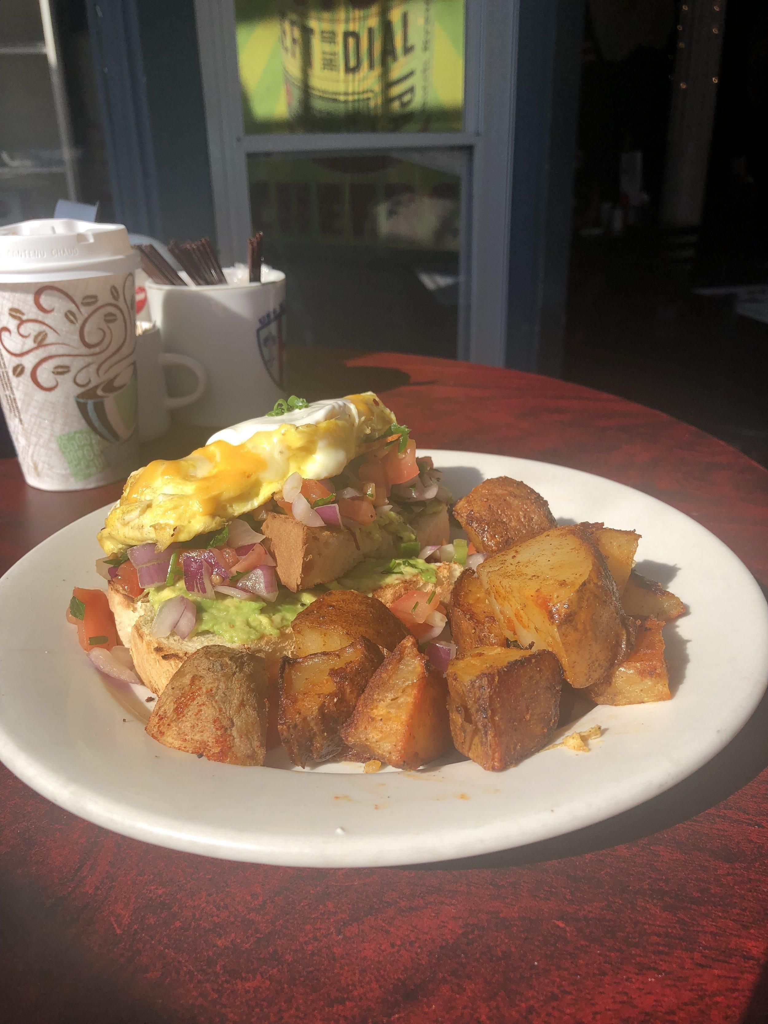 "Take a ""Pico"" This Toast! -  Avocado toast w/ fresh pico de gallo, scrambled eggs, cheddar-jack cheese, and sour cream."