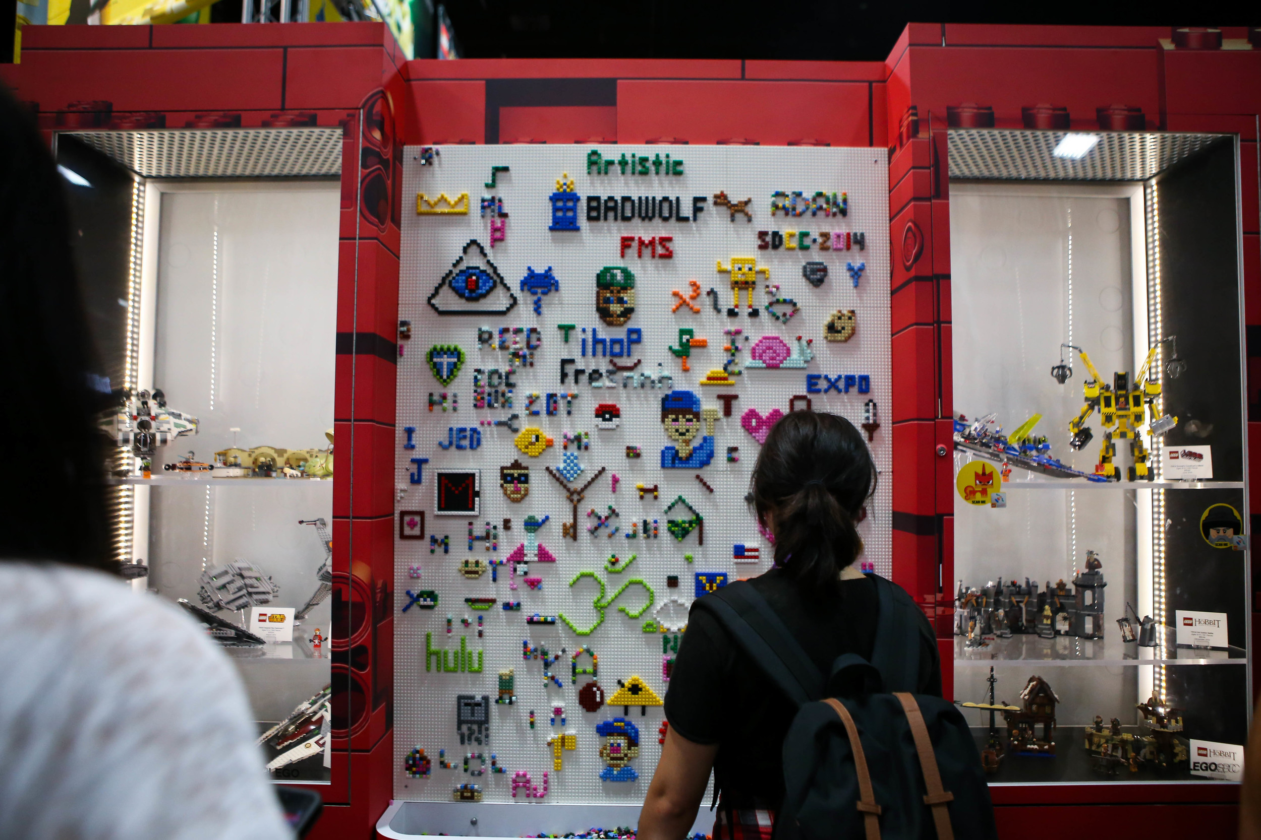 People getting intense on the Lego wall.