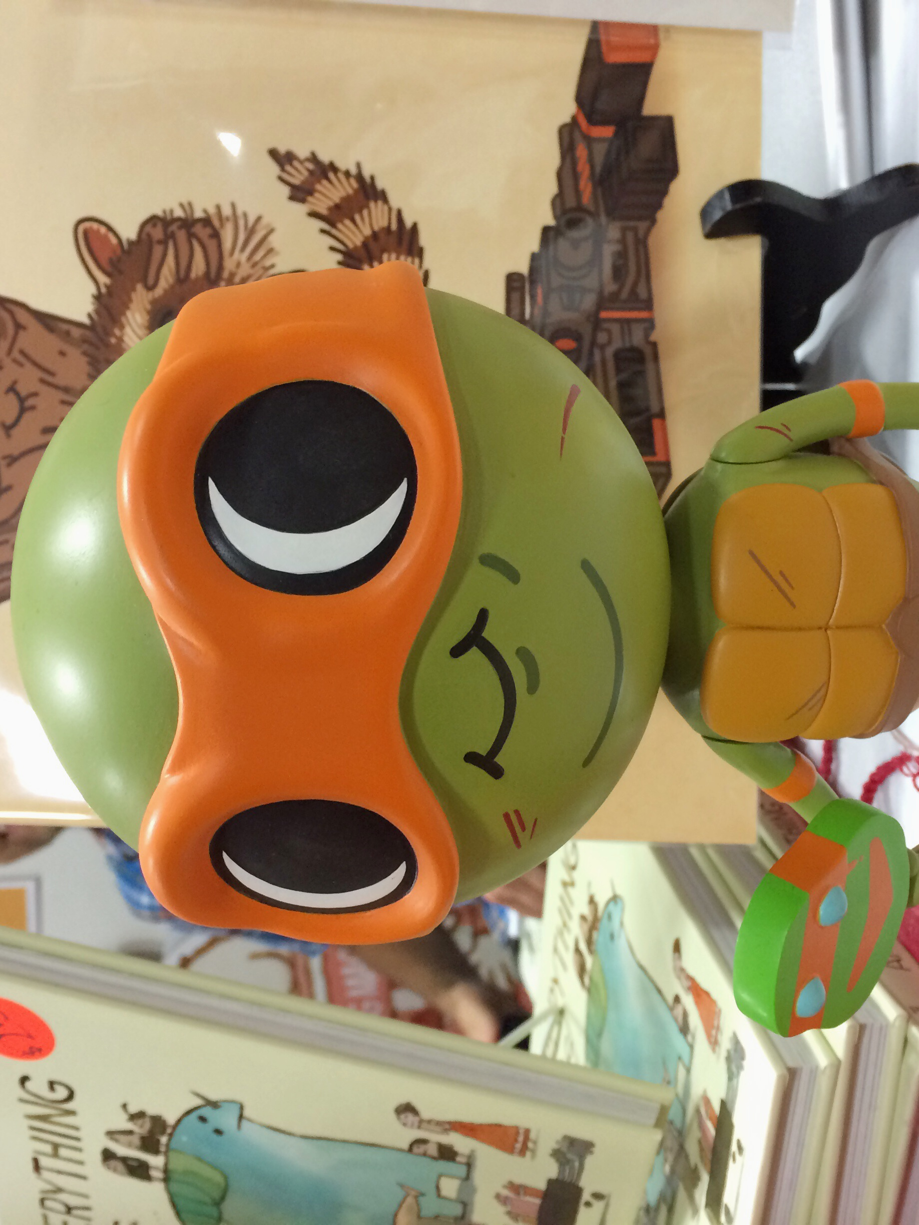 Mondo started with posters, moved into records, and now they're taking on toys. Of course, one of their first toys will be a Michelangelo based off Mike Mitchell artwork. I can't wait to go broke trying to get my hands on one of these!