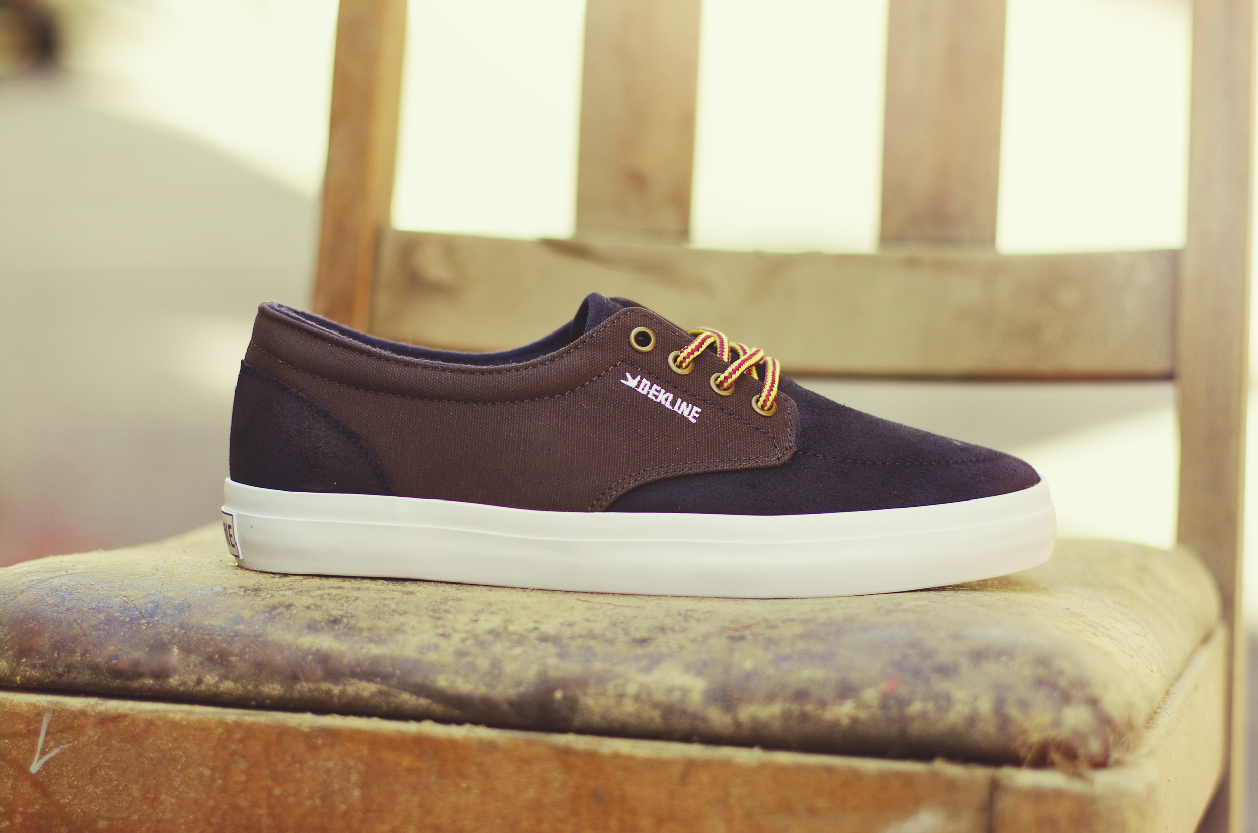 Mason - $65 (Brown/Navy/White) This shoe comes in a brown canvas/black suede upper with white vulc sole, metal eyelets and work boot laces.