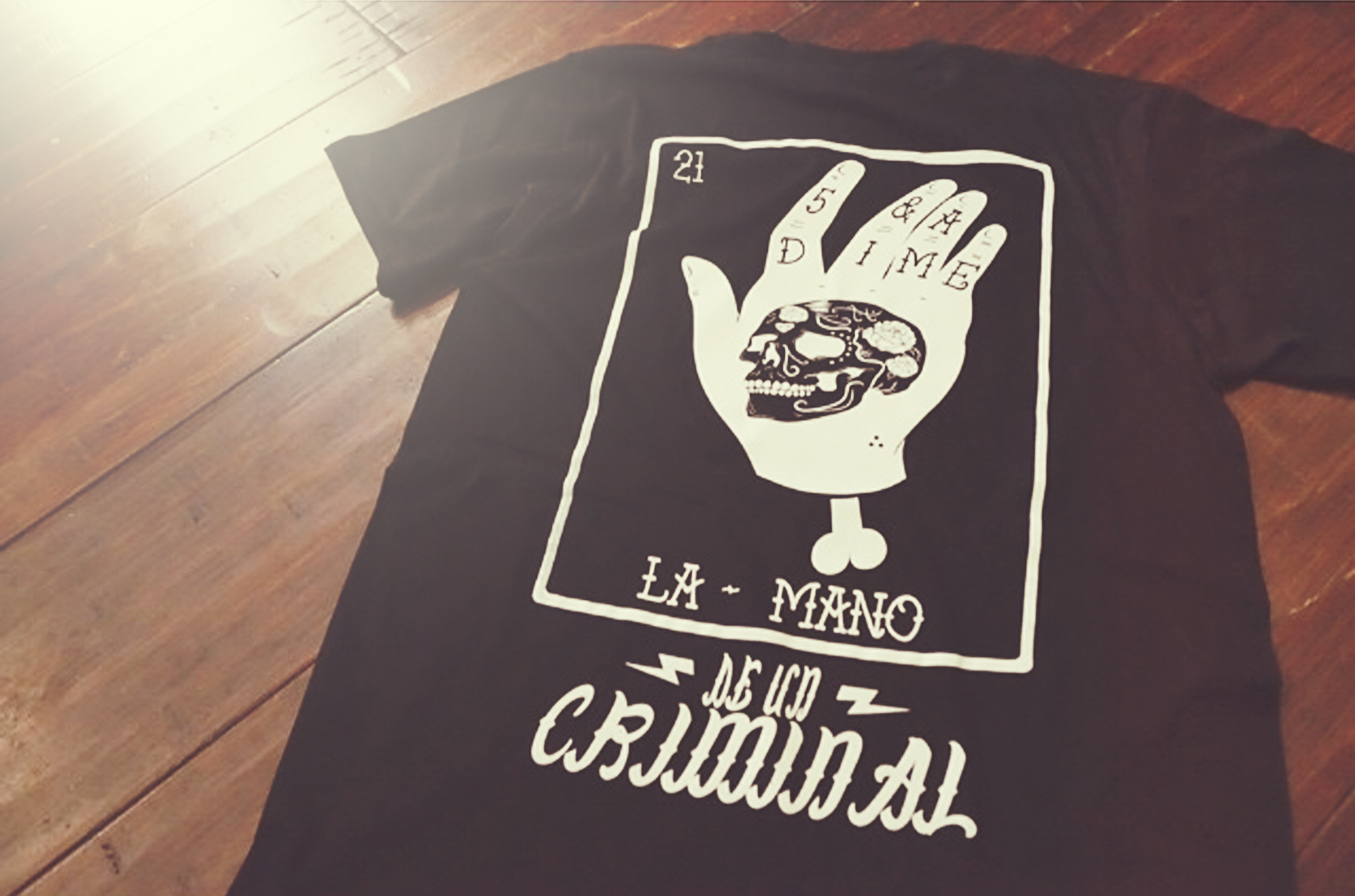 """5&A Dime: """"La Mano"""" ($30) This tee features a large back print, and a small left chest hit."""