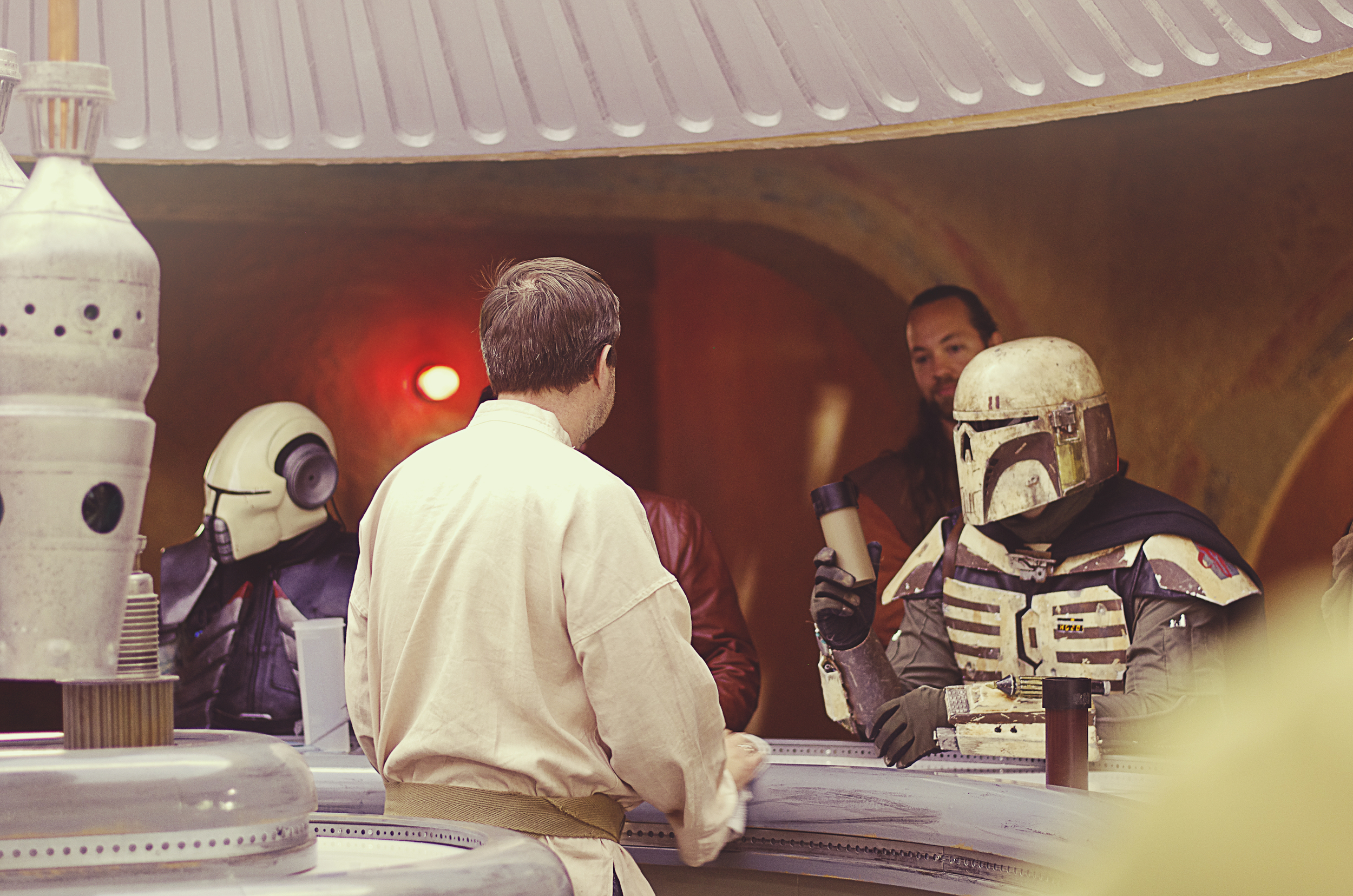 He was probably asking for a straw.  Nerd Fact: If you check out what's behind the bar on Mos Eisley, the hanging things behind the bartender are also used as IG-88's head.