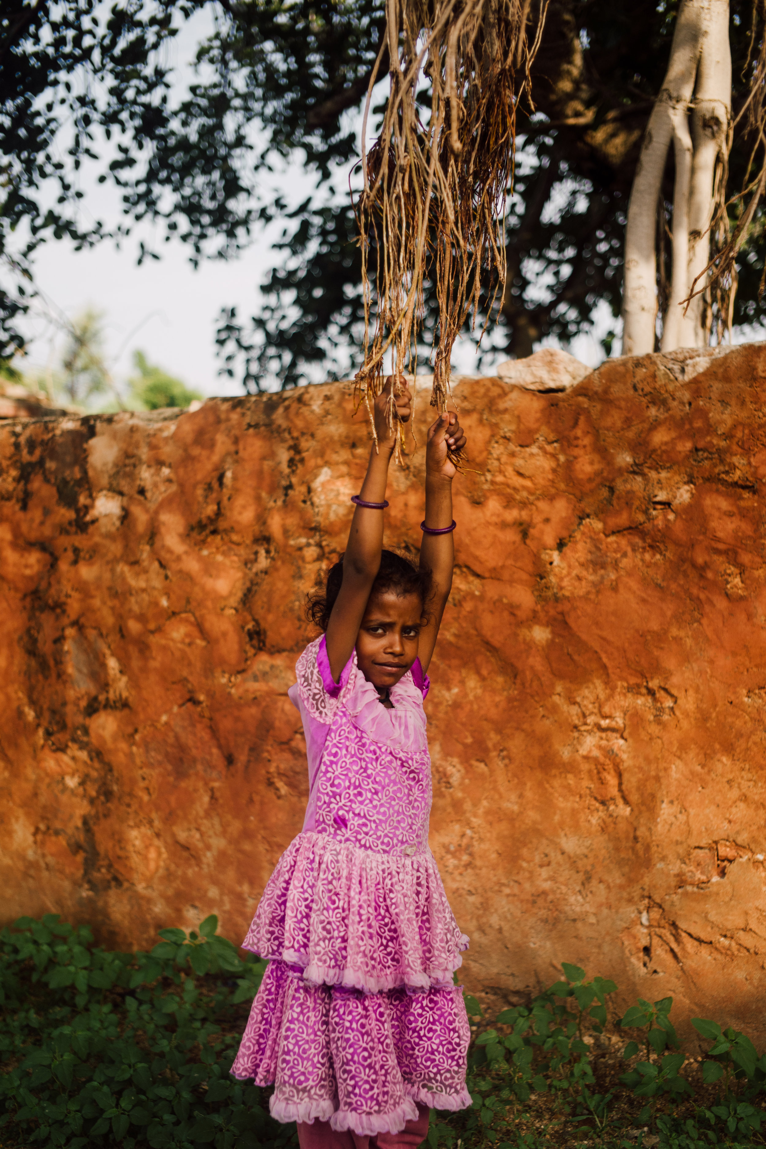 On my journey from Jodhpur to Udaipur, we pulled off the side of the road to take a breather. Here we found a girl swining from a set of tree vines, she would use these tree vines and the wall behind her as a makeshift swing.
