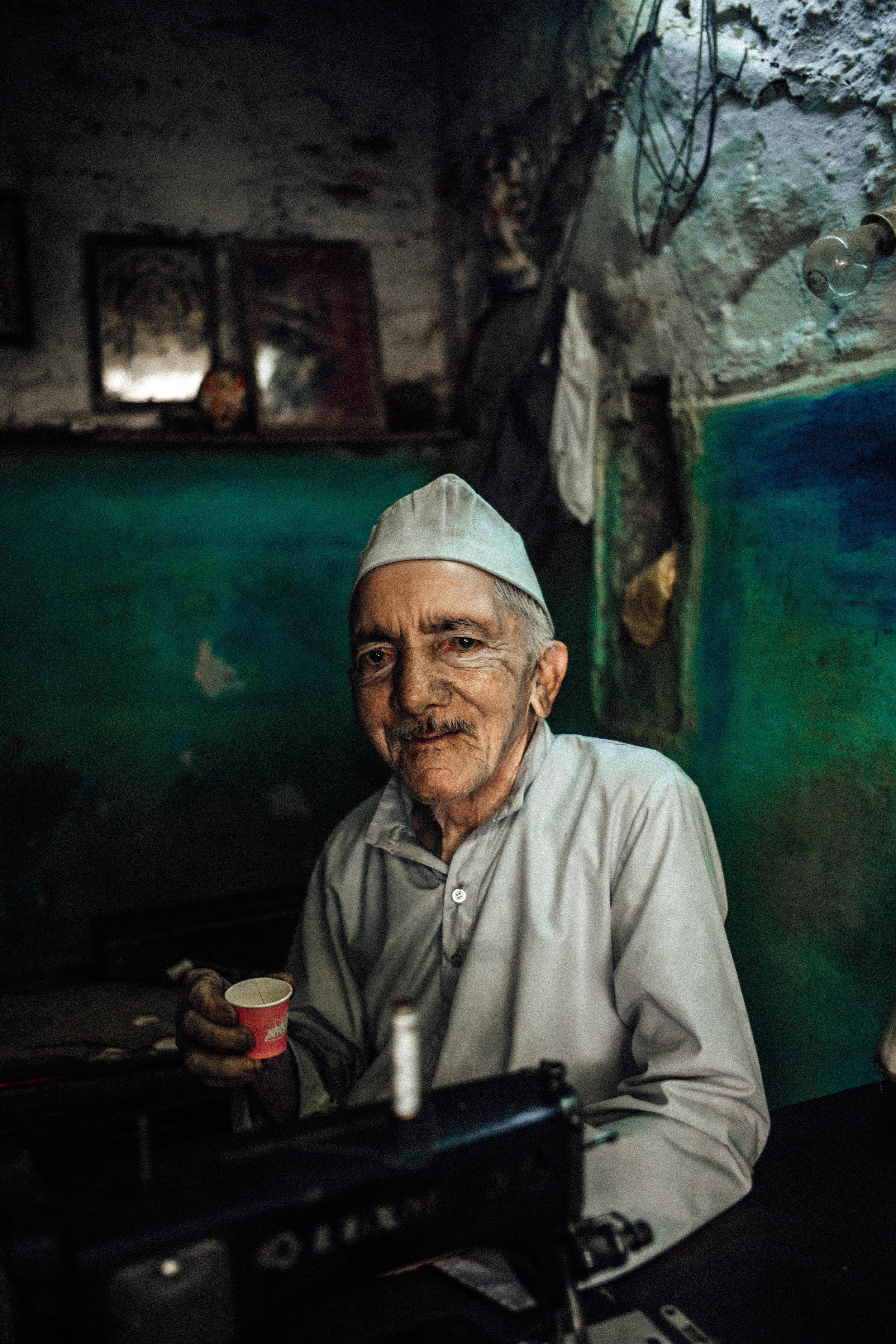 """A local street worker enjoying his cup of chai tea. A drink consumed for its healing properties and so popular you can likely find its makers known as """"Chai Wallas"""" on every street corner from the big cities to the desert outposts. -Udaipur, Rajasthan 2017"""