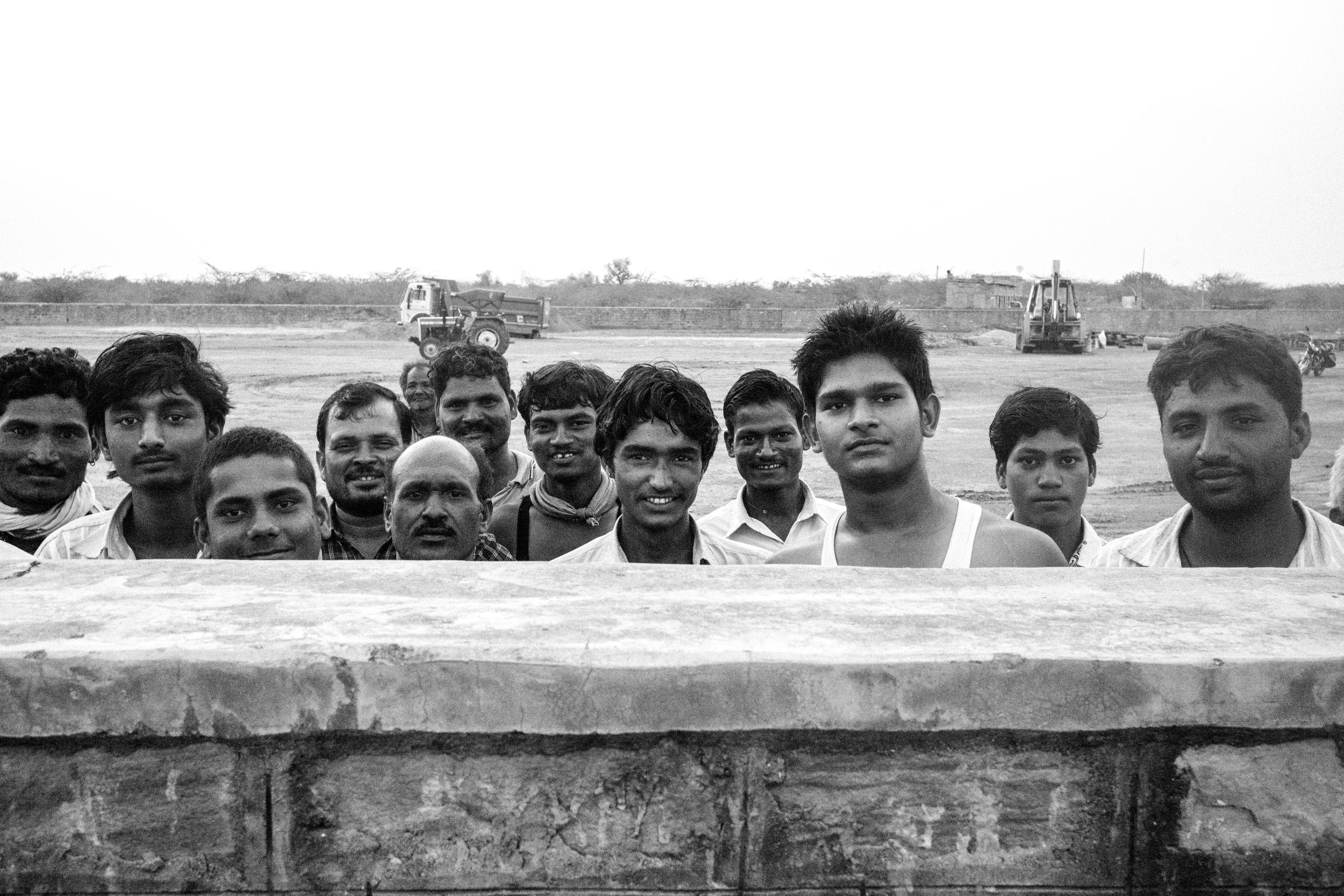 A group of workers gather to have their group portrait taken.