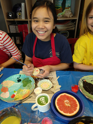 keily painting clay food.jpg