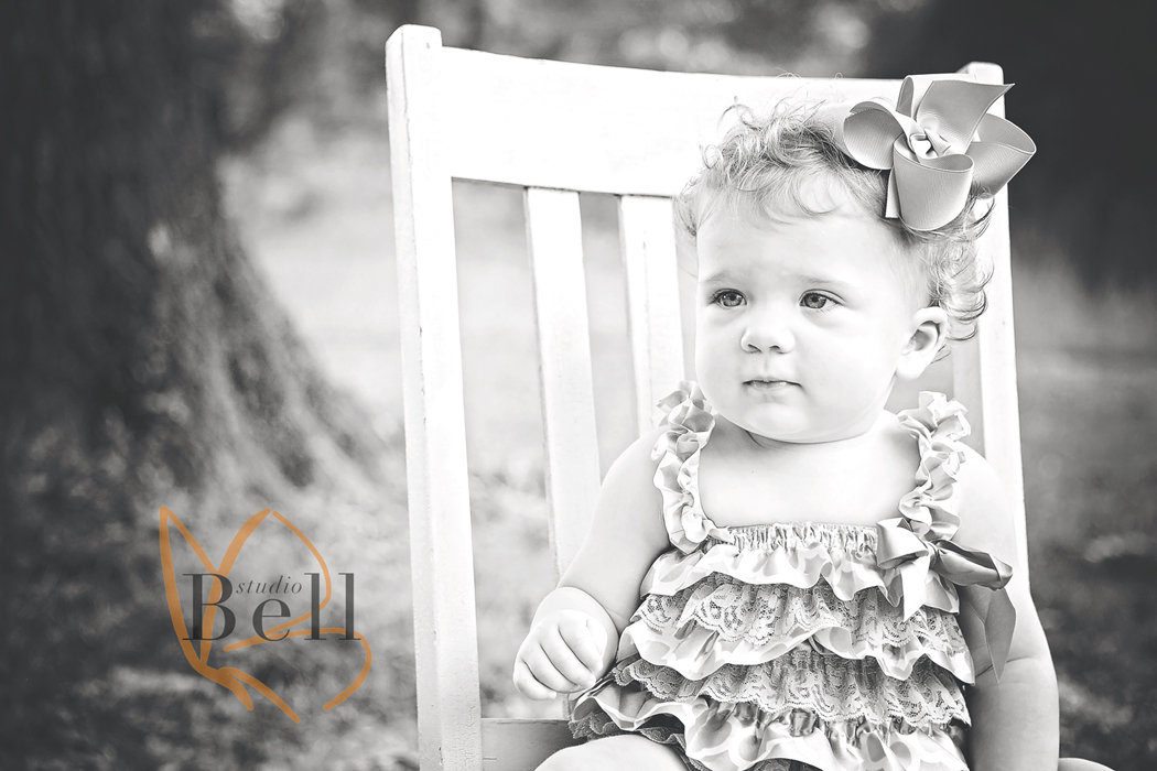 This photo just melts me. She looks like a little doll!