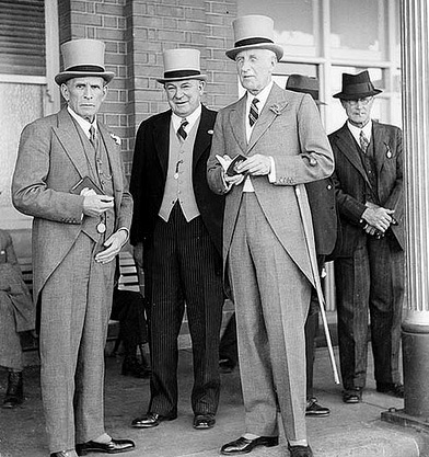 1937 The Sydney Cup. Top hat and tails. Details: pocket watches and FOBs.