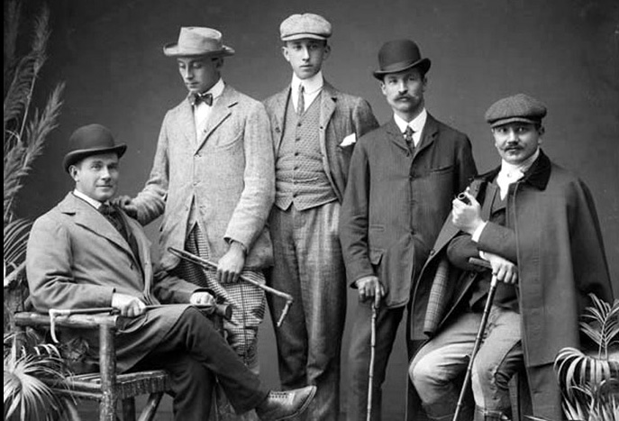 Est. 1903 at the Imperial Hotel. A group of dapper gents, looking very confident. All of the distinct styling details: Velvet collar, rounded collar with collar bar, bow tie, pocket square....these fellas have it goin' on!