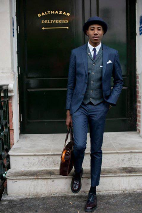 This well dressed fellow has it all put together perfectly. Proportion, lapel detail,  a bit conservative on the Pocket Square, mostly likely he had a serious business meeting, you can always switch out that detail for after hours.