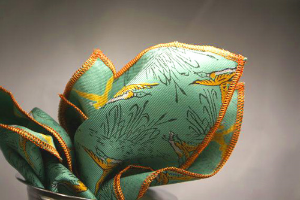 Here is an example of the crisp silk. It has some body to it so it really lends itself to either a straight fold or the tips. Conversation starter, featuring vintage men's neckwear silk with a sketched theme of ducks in a marsh. Personality in your pocket.