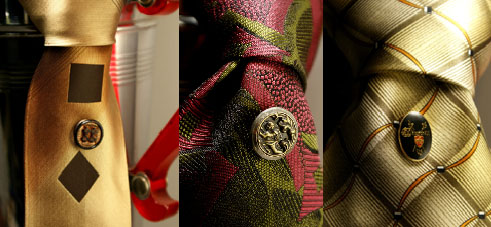 """Tie adornment details from left to right: Victorian gold painted black glass magnetic Mag TAK. Victorian metal picture button of an angel Mag TAK. Mantique Vintage """"Churchill"""" hat pin upcycled into a Mag TAK."""