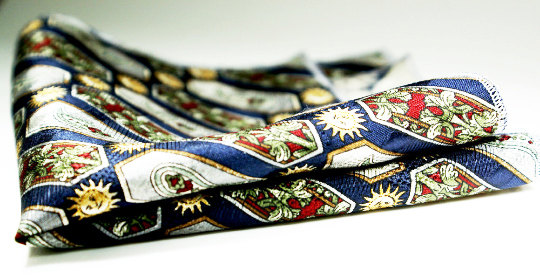 Elegant and classic textured silk in a navy print with contrast stitch edges