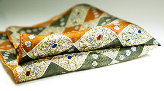 Cross over seasons pocket square in shades of sage and copper.