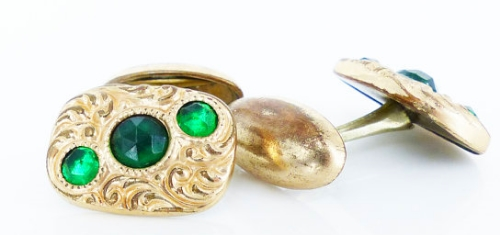 Antique jelly bean hardware set of gold cufflinks with inset emerald glass design.