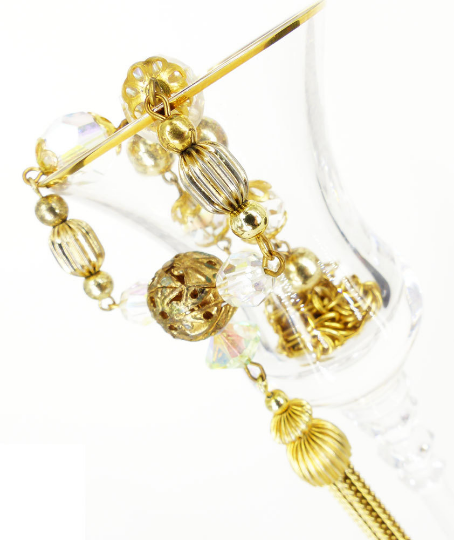 Estate finds, tassels, chime balls, crystals and pearls. Classic & timeless elegance.