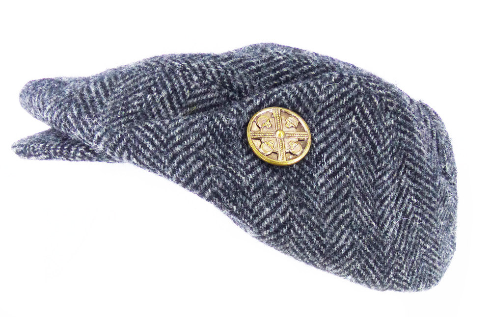 His or hers handwoven herringbone wool tweed Ivy in charcoal, drivers, newsboy cap or hat. Shown with an antique brass skull magnetic Mag TAK, magnetic pin.