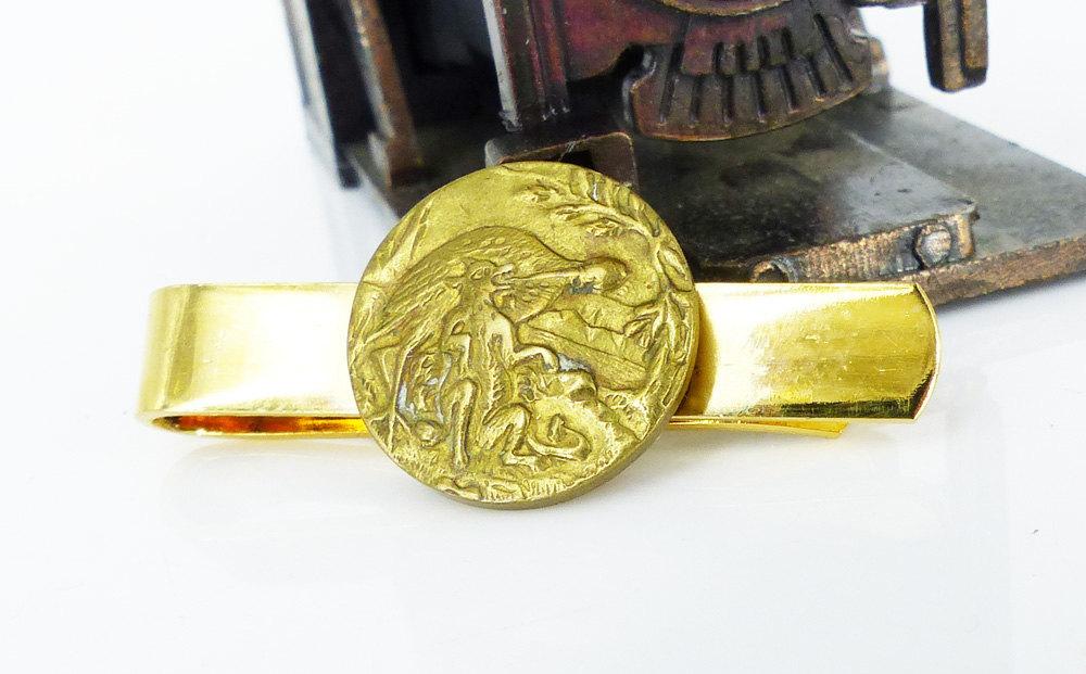 Antique Victorian brass story button tie bar