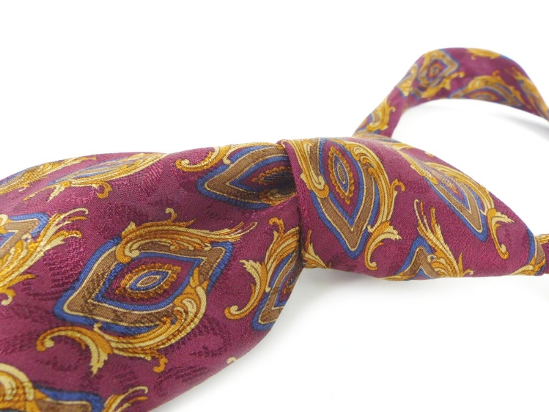 Hand sewn in Italy for Nordstrom silk necktie. Elegant scroll icons, burgundy background with details in gold and navy.