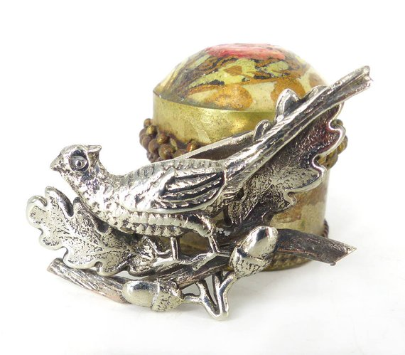 Antiqued silver pheasant on a branch lapel pin or brooch