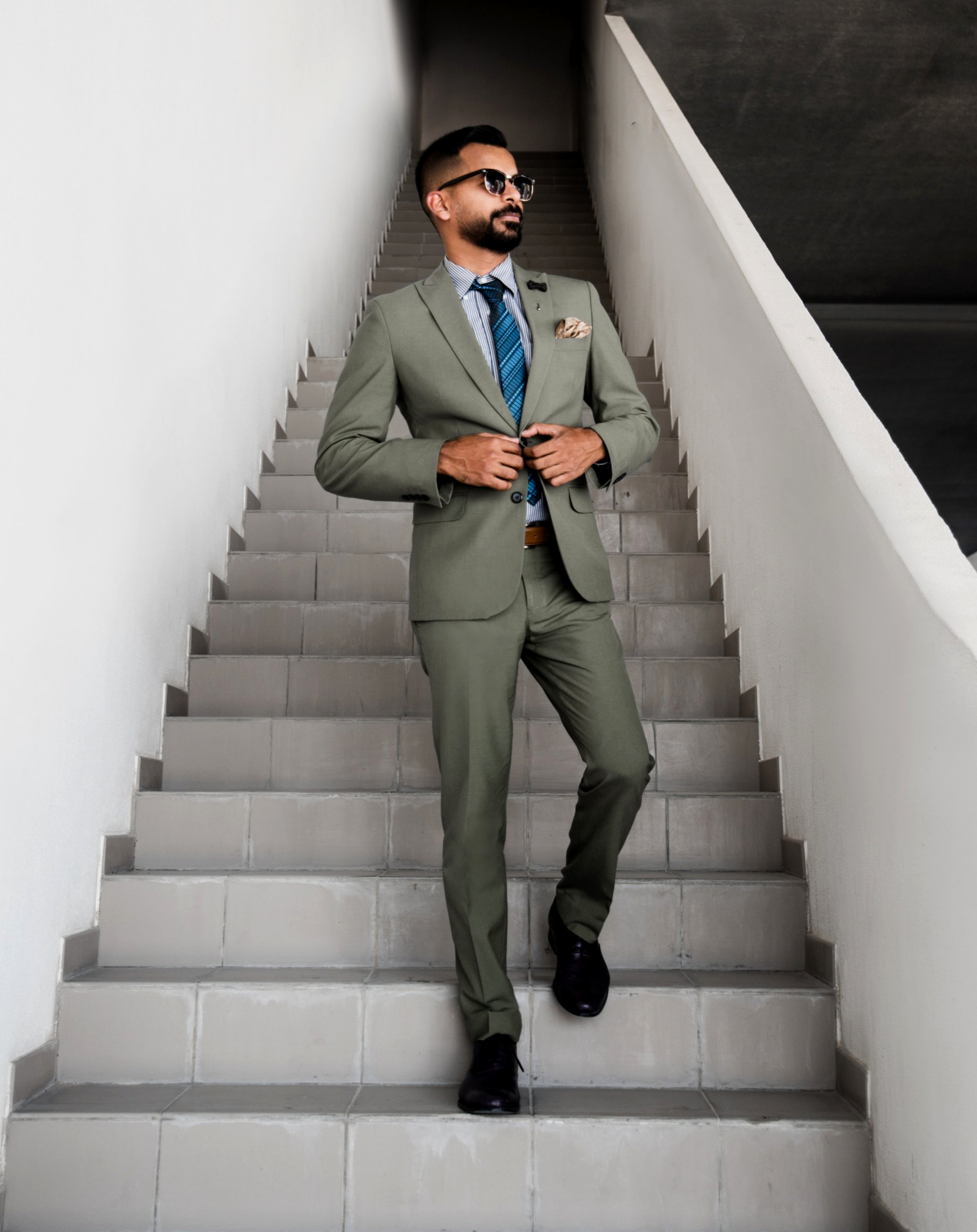Two tone, suit & tie - Cool green suit with a same cool feel pop of color tie.