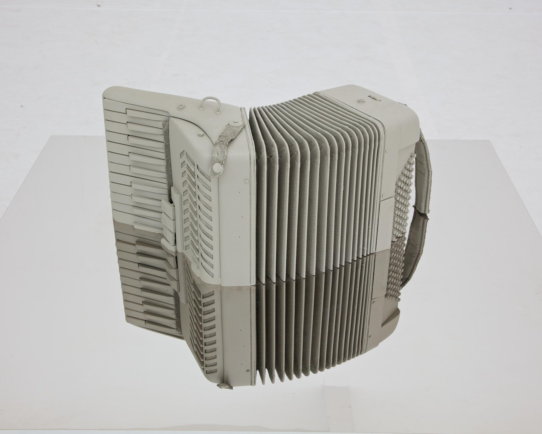 Ji Zhou 计洲, Object - Half an Accordion 物 - 半个手风琴, 2013, Half an accordion  and mirrored stainless steel 半个手风琴、镜面抛光钢板