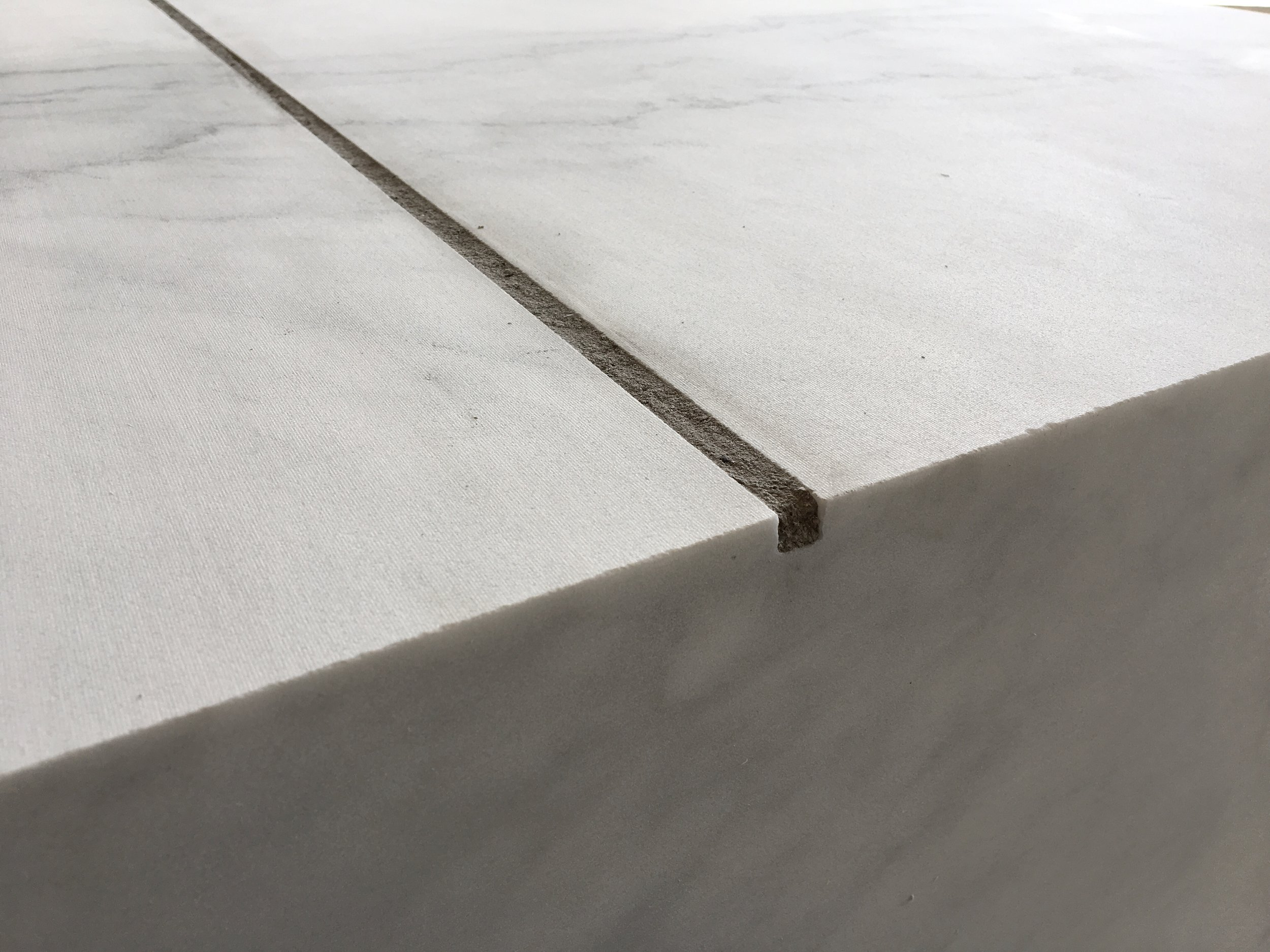 A Square Meter of Marble with a Linear Meter of Ash,  2018, marble, cigar ash, detail
