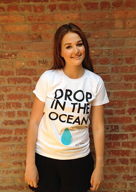 Riley wearing Oliver Proudlock's 'Drop in the Ocean' designer tee.