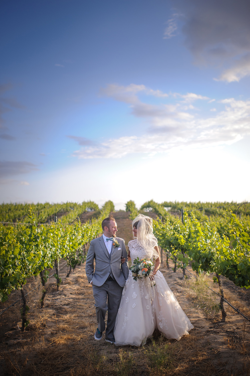 This was the most beautiful wedding day at Mount Palomar Winery. Big white puffy clouds, a bright blue sky, and vibrant green vines made for a beautiful backdrop for Angela and Nick's wedding portraits.