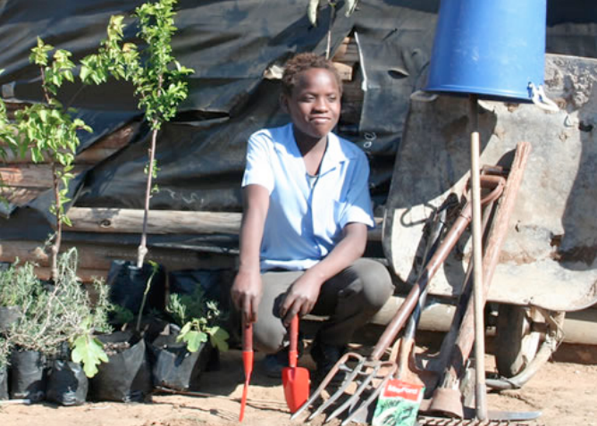 He now trades the excess from his small garden with neighbours in return for things like this school uniform, or offers his gardening services to others.