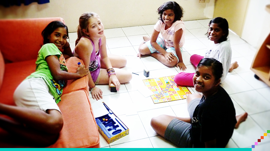 Jojo playing games with some of the older girls