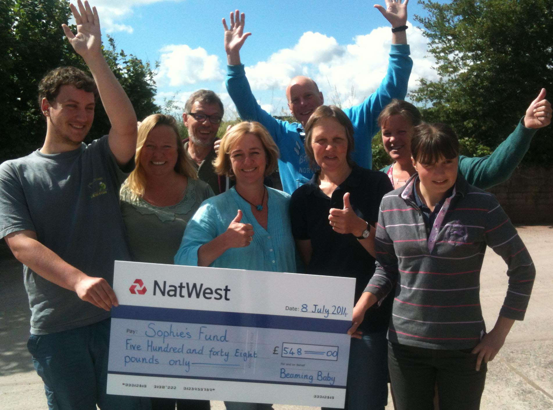 Staff at Beaming Babies handing over their cheque.