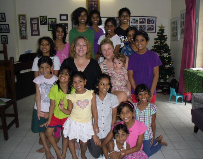Bernadette  and Claire with all the lovely smiley girls