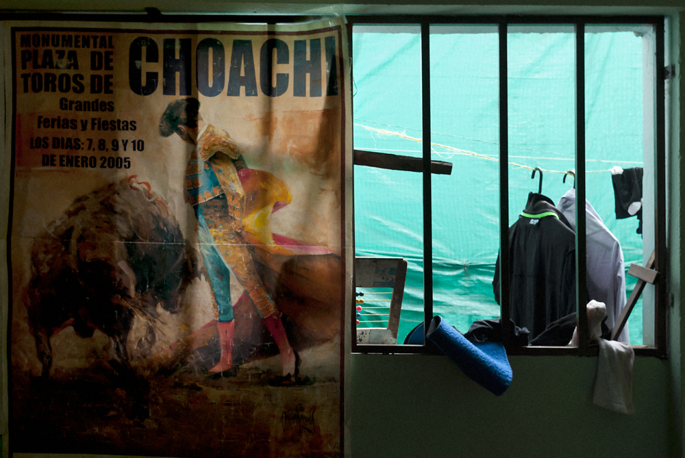Clothes hang to dry in a bull fighter's home.   In this series I photographed several young men who were training to become bull fighters in a small town called Choachí on the outskirts of Bogota, Colombia. They were committed to pursing this tradition, something they see as an art form, despite enduring an increasing amount of scrutiny from animal rights activists and an uncertain future.