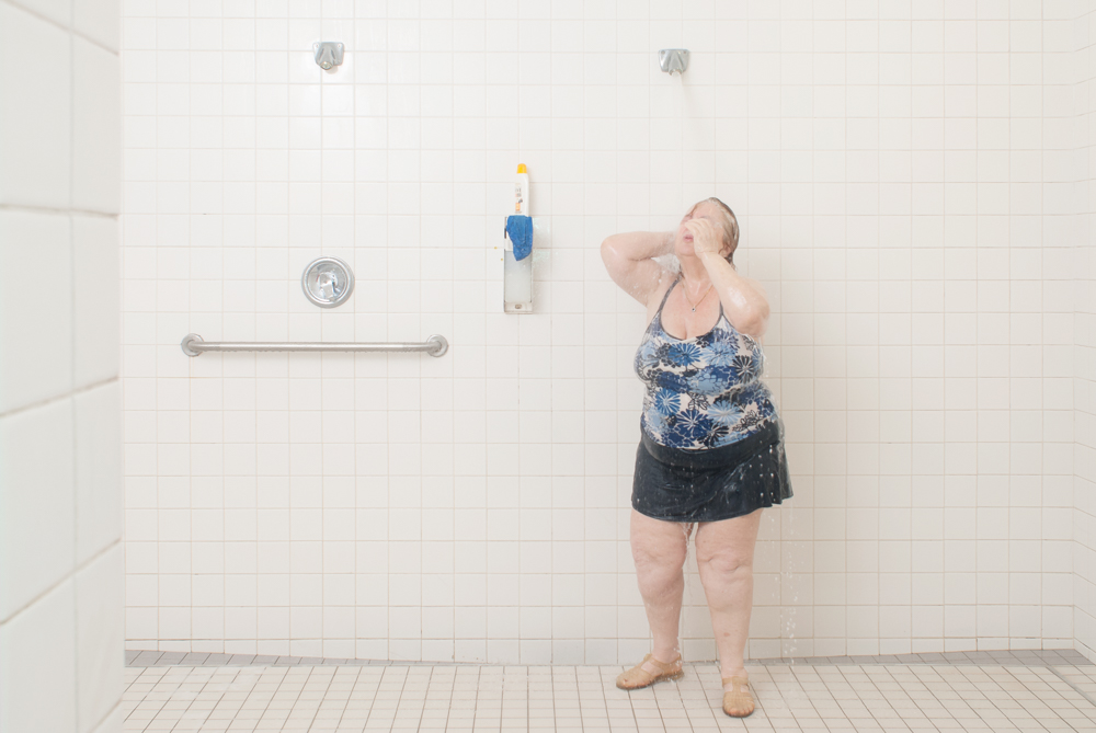 Shower  In this series, I documented the daily realities of the aquafitness participants at the Montreal Jewish Community Centre.For them, it is a shared experience of care and community that at times, wavers between the boredom of routine and the kindness, good humour and mutual support that accompanies growing old.