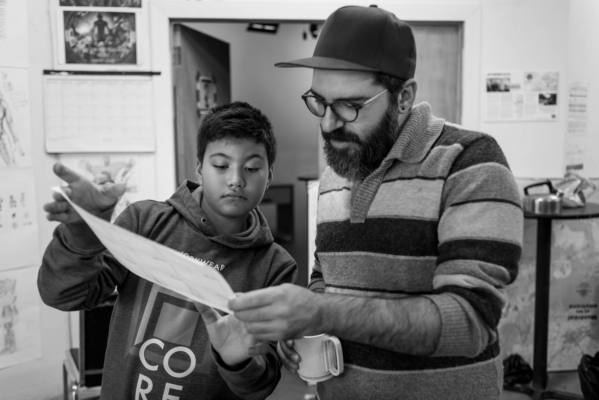 Raphael shows Felipe his revised story board for the animation he is creating.  Facilitator to participant feedback and support is essential to developing story ideas.  In this photo essay I show youth on the autism spectrum engaged in programming at Spectrum Productions.   Spectrum Productions provides an opportunity for youth to gather together - they imagine, story board, write scripts, draw and create video while interacting with each other and with staff, something that is not always an easy task.