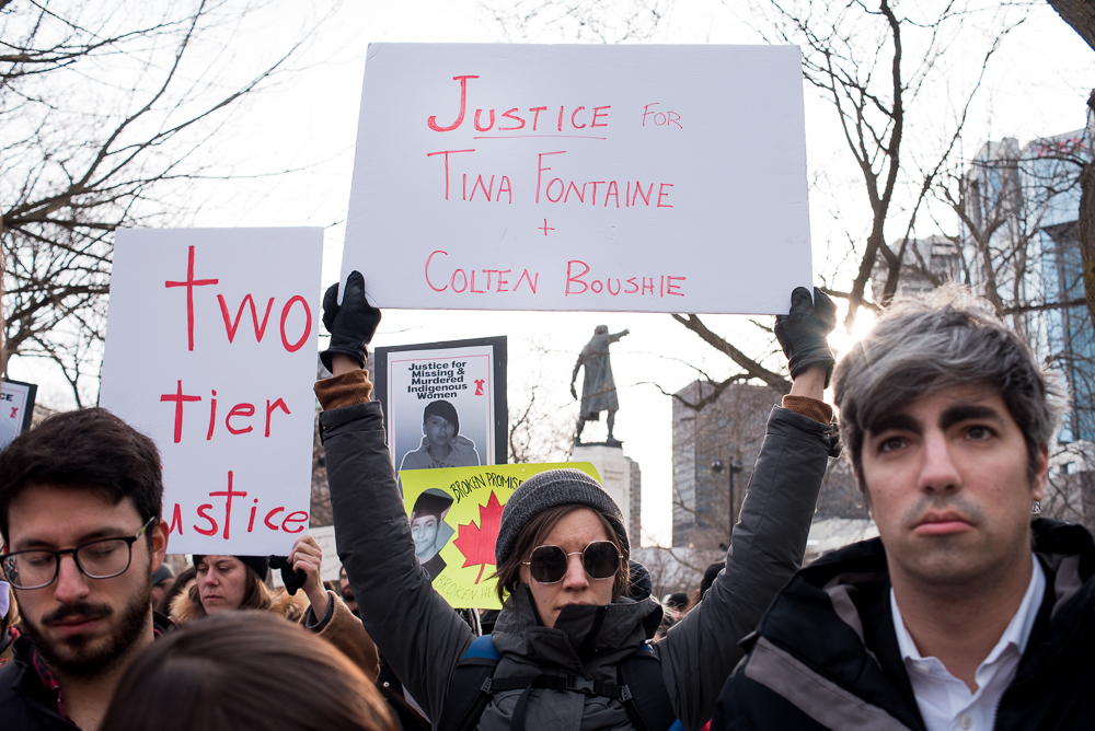 MONTREAL, February 24, 2018. Protesters hold signs at the Tina Fontaine Vigil in Cabot Square, Montreal. Fontaine was 15 years old when she died, she was found in a river in Winnipeg.
