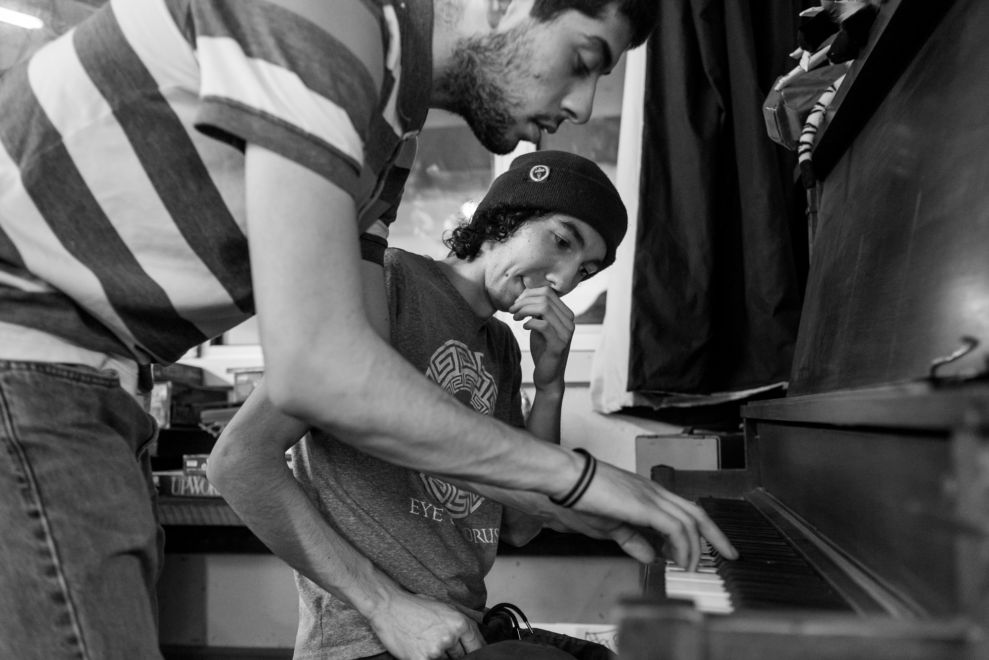 Marc-Antoine (right) and Anthony (left) play the piano after eating dinner at Friday Night Social Club.    In this photo essay I show youth on the autism spectrum engaged in programming at Spectrum Productions.   Spectrum Productions provides an opportunity for youth to gather together - they imagine, story board, write scripts, draw and create video while interacting with each other and with staff, something that is not always an easy task.