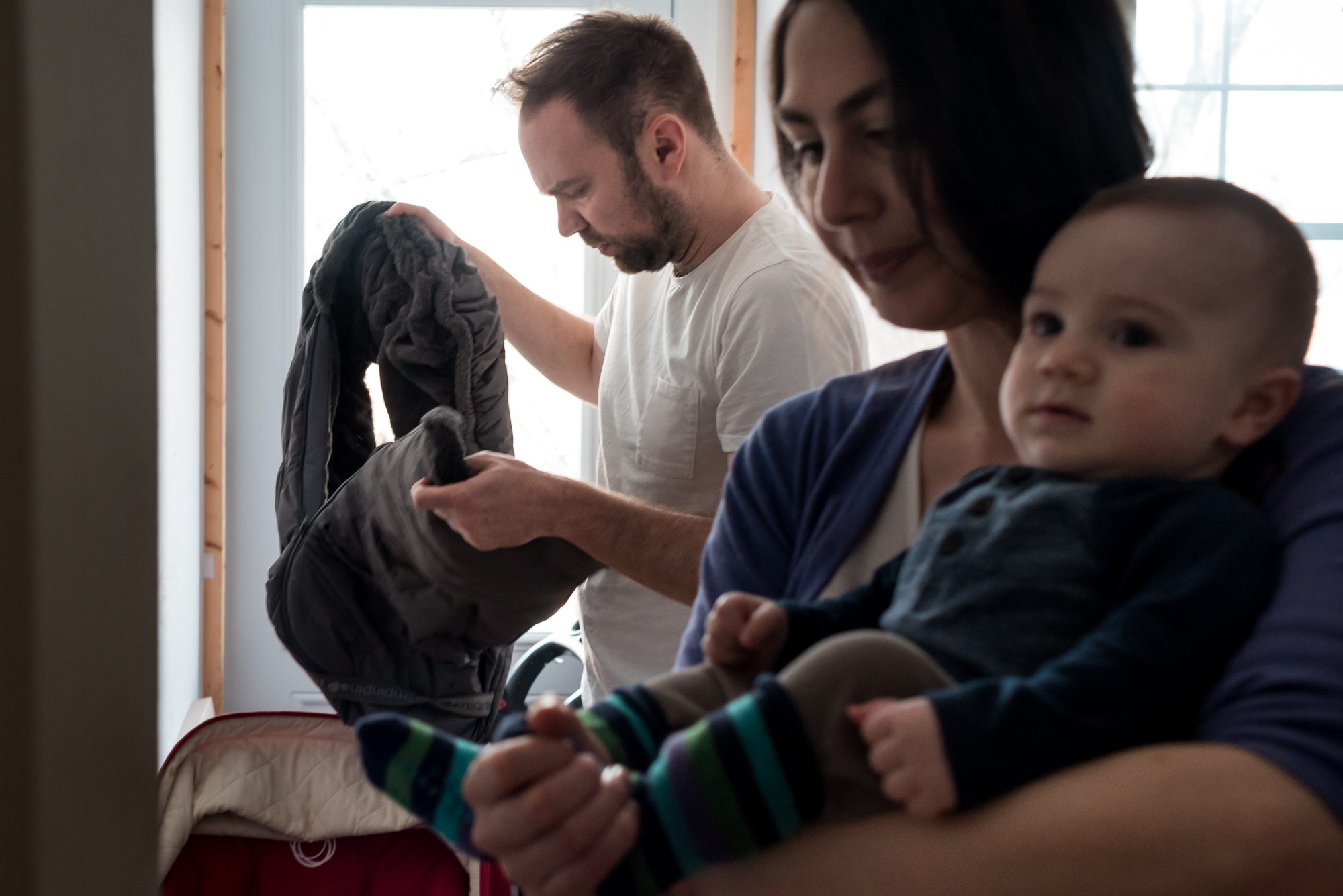 In this series, I reflect on traditional parenting roles by turning my lens on a new family.  Sarah and Fred had their first baby, Elliot, four months ago.  They invited me into their home to photograph them as they went about their day and we spoke about parenthood candidly.  For them, parenting is something they had been longing for for some time.  Although there are challenges, they have embraced their new life as a family with full hearts.