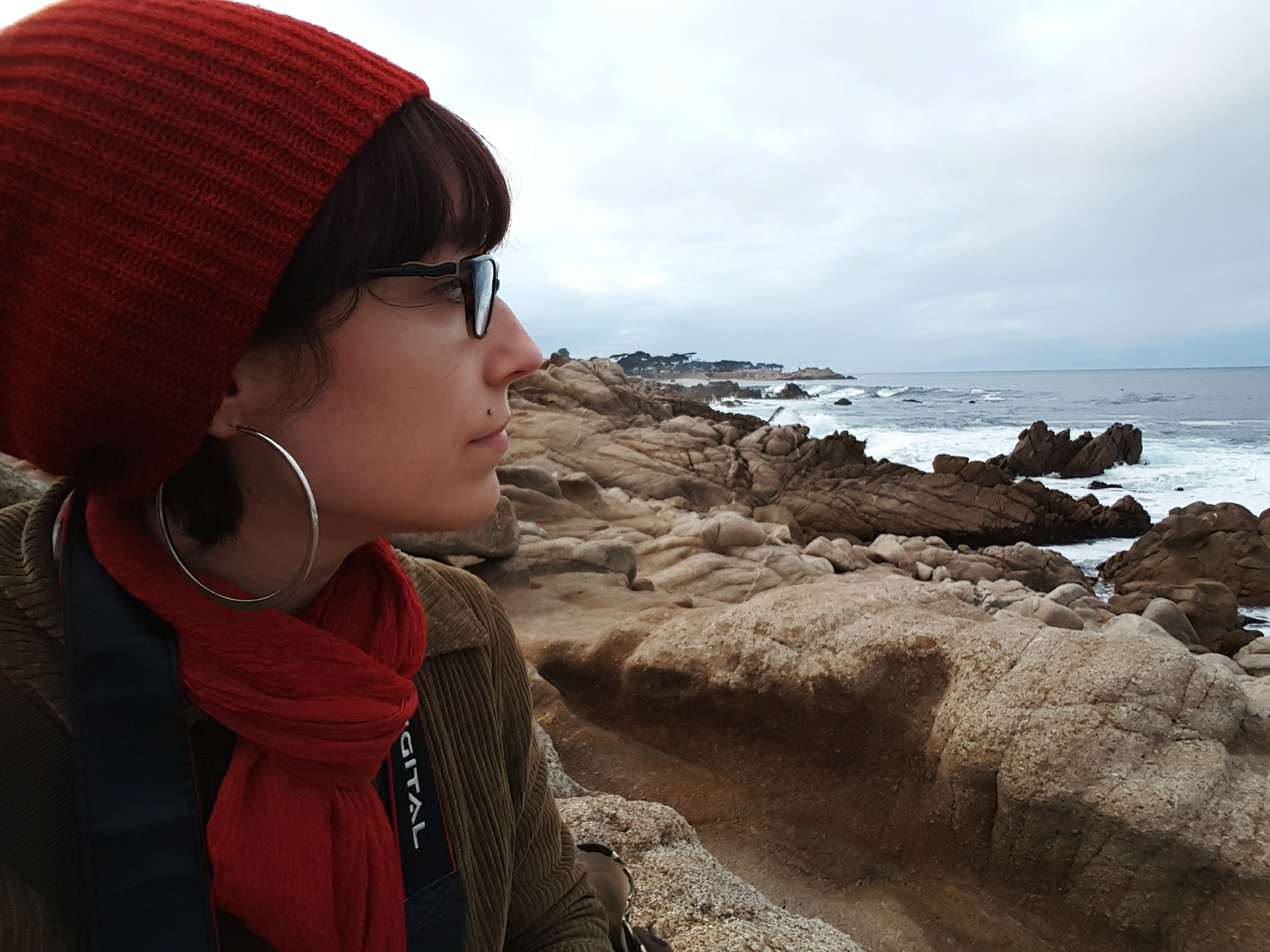 Listening to the crashing waves of the Pacific Ocean on the shore in Pacific Grove, CA
